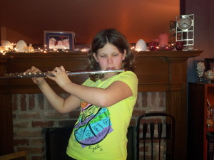 Sofia with her new flute from ChIRP.